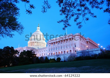 Capitol Hill Building at dusk with light and blue sky, Washington DC.