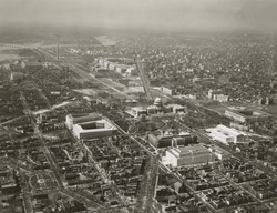 Capitol Hill transformed by new 1930's buildings. Aerial view to northwest. The additions include Library of Congress Adams building, House and Senate office buildings, and the Supreme Court. On the n