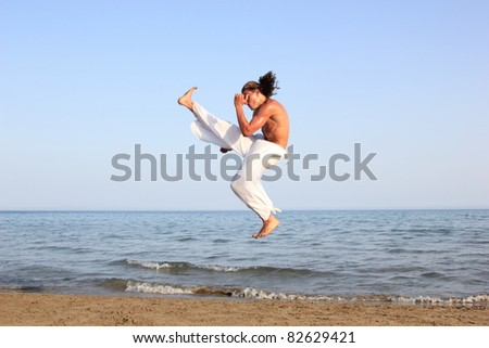 Capoeira dancer on the beach