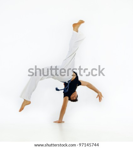 Capoeira guy making a coup
