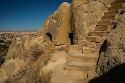 Cappadocia, Anatolia, Turkey: Degrees in the rock lead to the Church. The world heritage list of UNESCO