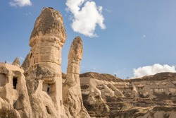 Cappadocia rock and mountain sandstone formations. Mushroom shaped unusual rock structures over canyon landscape