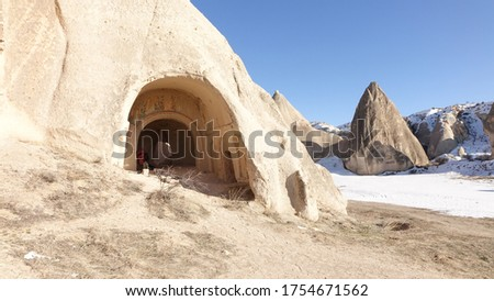 Cappadocia rock cave with rock carvings near the city of Göreme with snow during winter in central Turkey. Stok fotoğraf ©