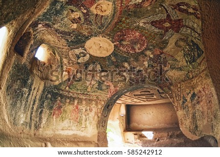 Cappadocia ,Turkey - October 20 ,2016 : Wall art of old frescoes in the  Church , Goreme