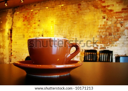 Cappuccino coffee cup and saucer in a funky interior