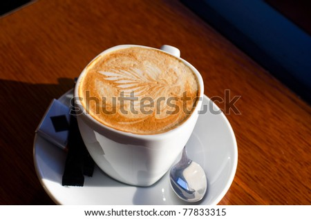 Cappuccino coffee cup closeup at the table