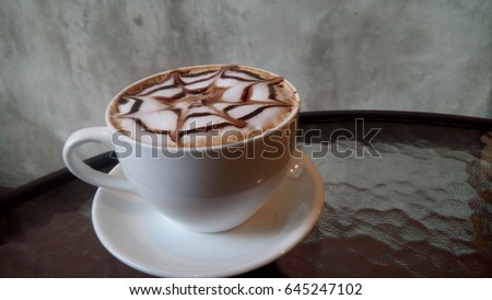 cappuccino coffee cup on the table #645247102