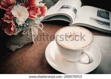 Cappuccino coffee with flowers bouquet