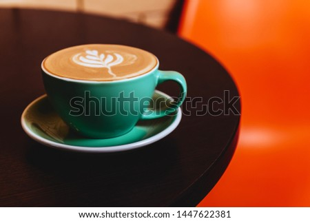 Cappuccino. Cup of Cappuccino Coffee on orange background #1447622381