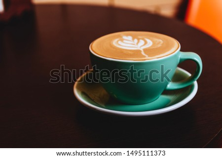 Cappuccino. Cup of Cappuccino Coffee on orange background #1495111373