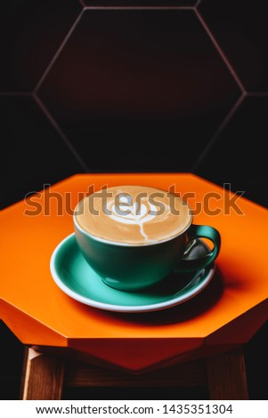 Cappuccino. Cup of Cappuccino Coffee on orange table #1435351304