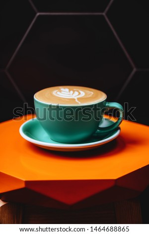 Cappuccino. Cup of Cappuccino Coffee on orange table #1464688865