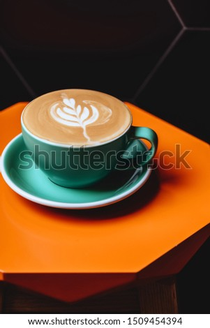Cappuccino. Cup of Cappuccino Coffee on orange table #1509454394