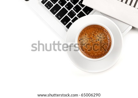 Cappuccino cup on laptop. Above view. Isolated on white background