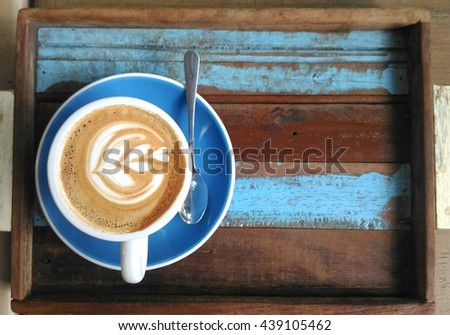 cappuccino cup on top old wood table #439105462