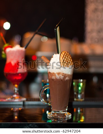 Cappuccino Frappe with fancy red cocktail on background
