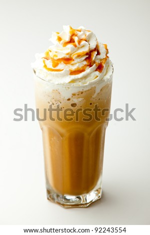 cappuccino frappe with whipping cream and butterscotch topping on white background