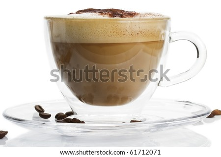 cappuccino in a glass cup with chocolate powder on white background