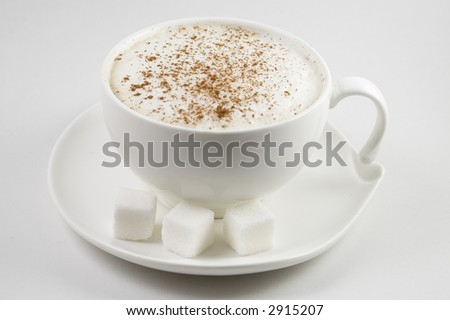 Cappuccino in cup on saucer