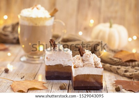 Cappuccino soaps with cinnamon sticks on top and fall decorative items around it.
