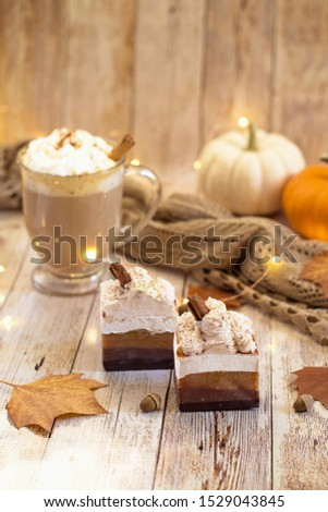 Cappuccino soaps with cinnamon sticks on top with fall decorative items around it.