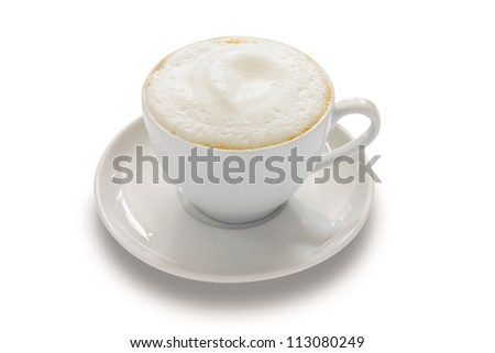 Cappuccino with a frothy white top in a white ceramic cup over a white background
