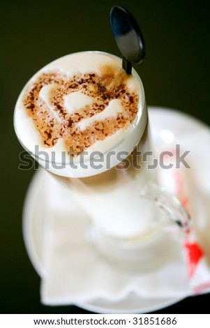 cappuccino with a heart shape of cocoa