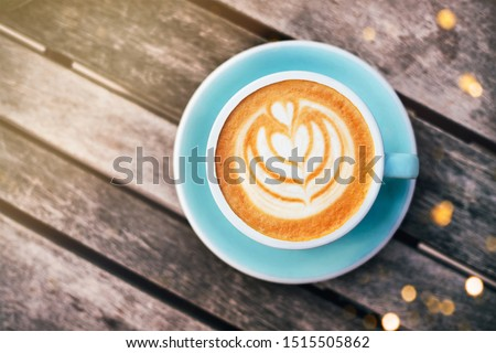 Cappuccino with frothy foam, blue coffee cup top view closeup on gray wooden background. Flat lay style. Stok fotoğraf ©