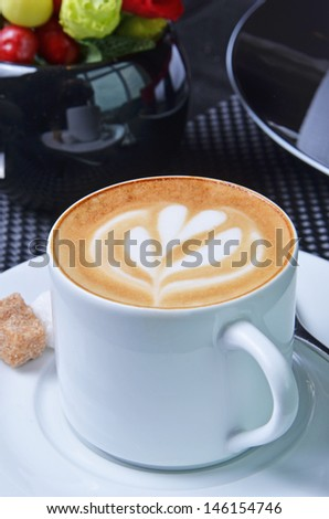 Cappuccino with latte art on the crema. - stock photo