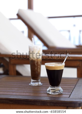 cappuccinos served at a balcony with two sunbeds