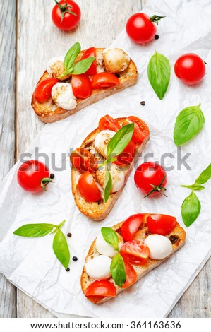 Caprese bruschetta on a white wod background. toning. selective Focus - Shutterstock ID 364163636