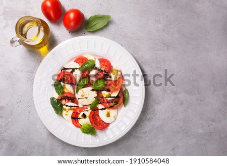 Caprese salad. Italian famous salad with fresh tomatoes, mozzarella cheese and basil, top view with copy space Stok fotoğraf ©