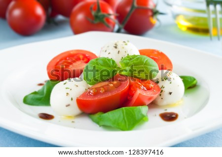 Caprese salad with baby mozzarella and cherry tomatoes