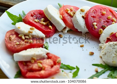 Caprese salad with mozzarella and pine nuts