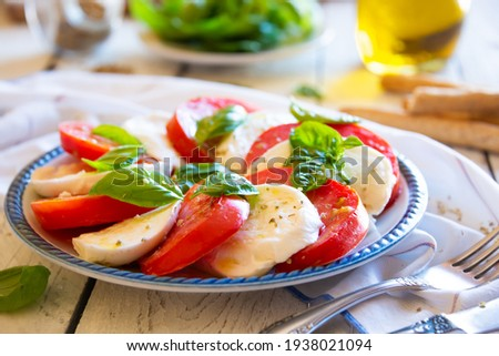 Caprese salad with  mozzarella cheese, tomatoes and basil. Typical Italian cuisine Stok fotoğraf ©