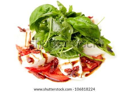 Caprese salad with ruccola and dried tomatoes