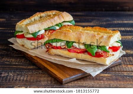 Caprese sandwich with tomatoes, mozzarella, basil and bacon. Healthy eating. Italian cuisine Stok fotoğraf ©