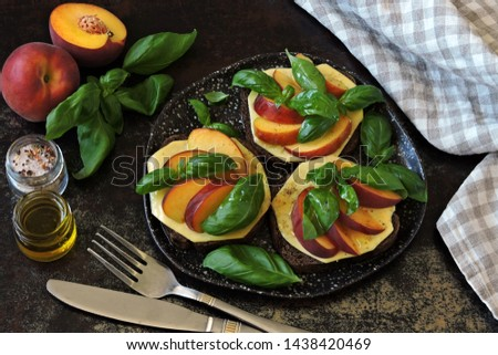 Caprese toast with peach, cheese and basil. Healthy toasts. Keto diet. #1438420469