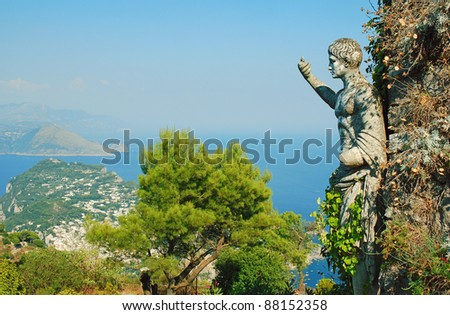 Capri island and statue pointing