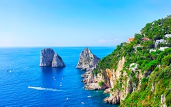 Capri Island with Faraglioni of Italy at Naples. Amalfi scenery and Solaro mountain. Landscape with Blue Mediterranean Sea at Italian coast. Panorama of Anacapri in Europe. View in summer.