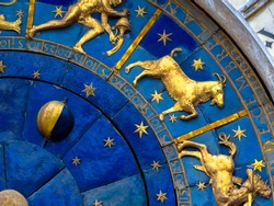 Capricorn astrological sign on ancient clock. Detail of Zodiac wheel with Moon and constellations. Golden symbol of Capricorn on star circle closeup. Concept of astrology and horoscope.