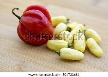 Capsicum Chinenses, Habanero Red and white habaneros on wooden table, ripened very hot fruit
