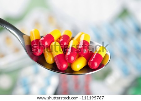 capsule pills in spoon - stock photo