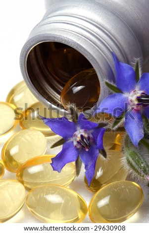 Capsules of borage oil and borage flowers.