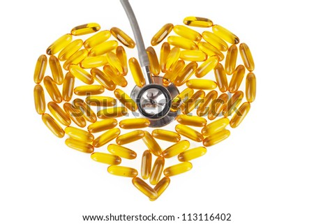 Capsules of fish oil with stethoscope. Shot in studio