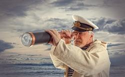 Captain looks through a telescope