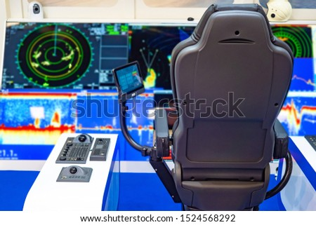 Captain's bridge. Boat management. Cabin control ship. Modern equipment on a yacht. The place of the captain of the ship. Electronics on the captain's bridge. Fragment of a yacht control cabin. #1524568292