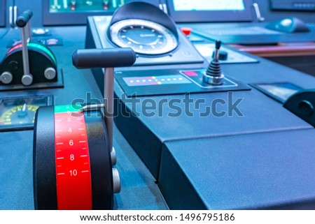 Captain's bridge. Speed controller on the boat. A fragment of the control panel of the ship. Management of a ship. The concept is acceleration, speed increase. Equipment for the civilian fleet. #1496795186