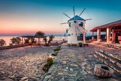 Captivating morning view of Potamitis Windmill. Colorful spring sunrise on Zakynthos island, Korithi location, Ionian Sea, Greece, Europe. Beauty of countryside concept background.
