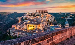 Captivating summer cityscape of Ragusa town with Palazzo Cosentini and Duomo di San Giorgio church on background. Colorful sunset in Sicily, Italy, Europe. Traveling concept background.